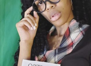 DaPurpleSharpie with fake glasses on holding a book titled 'Optimal Combos'